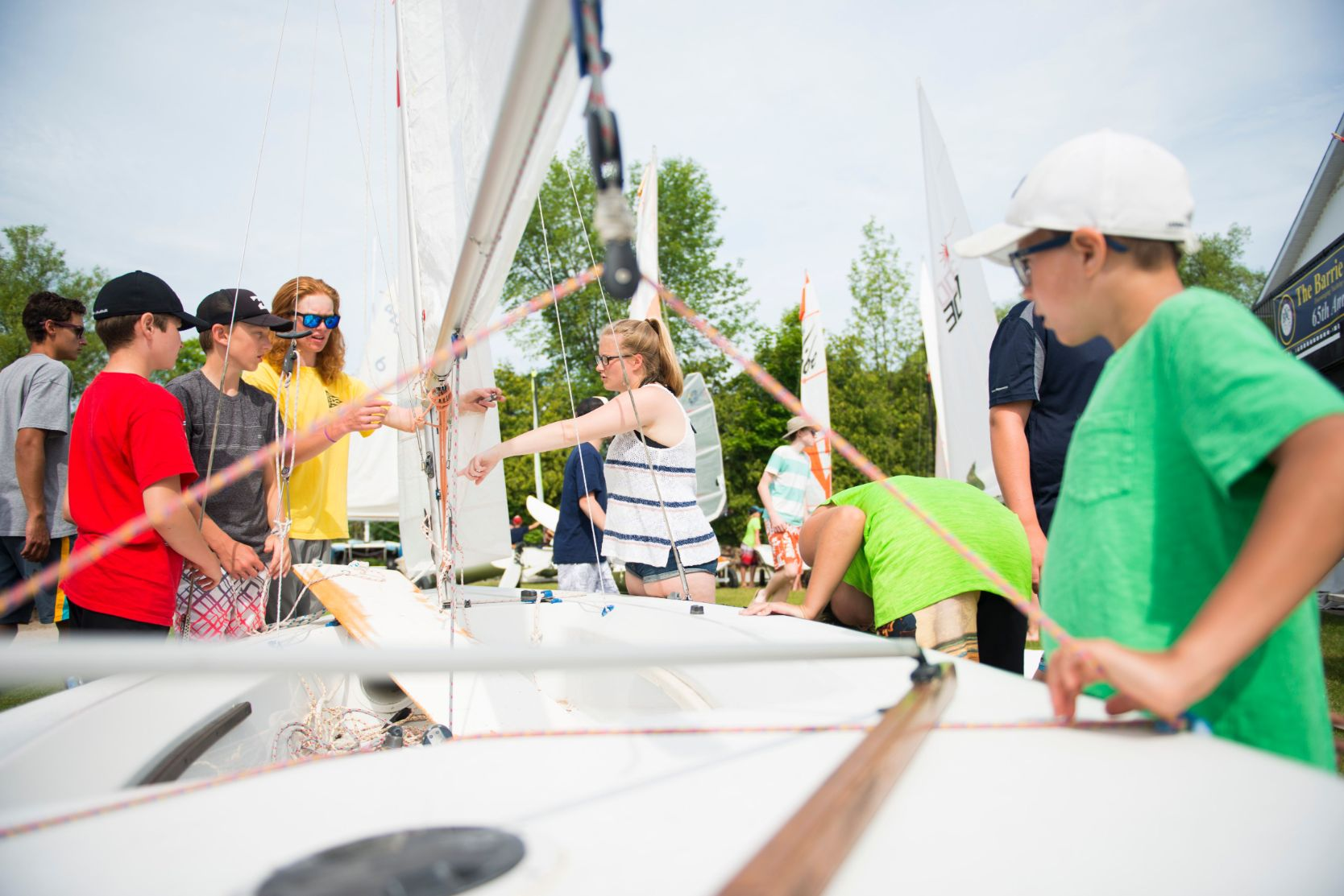 adult sailing on Kempenfelt Bay in Barrie Ontario